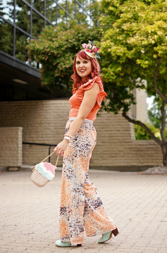 Winnipeg Fashion Blog, Canadian Fashion Blog, Catherine Malandrino coral papaya peach ruffle sleeve silk top, BCBG Max Azria Joan printed splash pattern wide leg pants, BCBG Max Azria white scalloped waist belt, Self made DIY summer butterfly fascinator hat, Aldo accessories cupcake clutch handbag, The Shopping Channel Aquamarine rose carved mother of pearl necklace and bracelet, Marc Jacobs white leather watch, Fluevog Operetta Fiorenza mint slingback leather heels