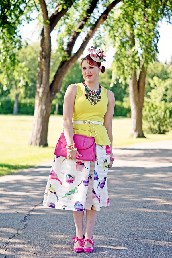 Winnipeg Canadian Fashion Consultant Stylist blog, Chicwish spring cruise birds print midi skirt, BCBG Max Azria Tribal statement stone bib necklace, Devoted yellow peplum top, BCBG Max Azria toggle belt, self made DIY butterfly disc fascinator, Bodhi handbags fuchsia pink safety pin clutch handbag, Isaac Mizrahi bow watch, Betsey Johnson lip bangle, John Fluevog pink ivory bow Miracle Revelation pump heels