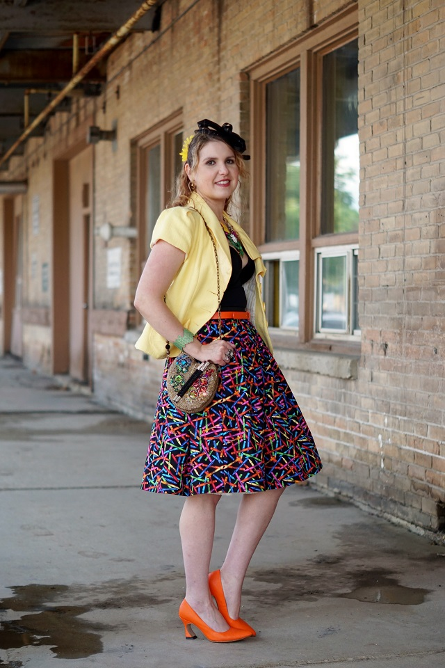 Winnipeg Style Canadian Fashion Stylist Blog, Nanette Lepore bow yellow short sleeve blazer jacket, Vedette Pamela shaping swimwear, Mary Frances painter's palette beaded handbag clutch bag, Etsy PicknMix crayon printed circle full skirt, Danier leather orange belt, dconstruct eco-friendly honeycomb cuff bracelet, Icing fascinator hat, John Fluevog Big Presence Desmond yellow linen pumps
