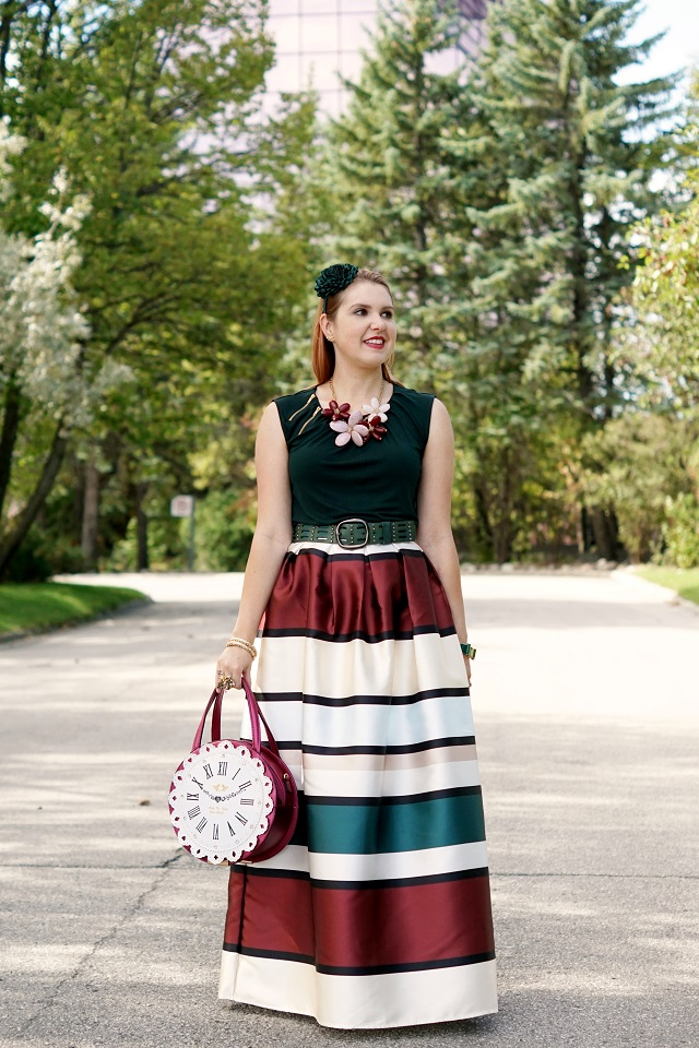 Winnipeg Style, Canadian Fashion blog stylist, Chicwish fall tones stripes striped maxi skirt, Darling's clock vintage style retro handbag, RW & co. hunter green zipper top, Danier leather green studded belt, Aldo Accessories bold statement flower necklace