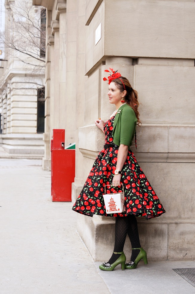 Winnipeg Style, Milliemeno retro vintage style red cherry print pin up halter dress, INC International Concepts green shrug, Precis petite red feather flower fascinator, Chie Mihara Geraldine green eyelash shoes, Kate Spade chinese take out box clutch handbag, Canadian