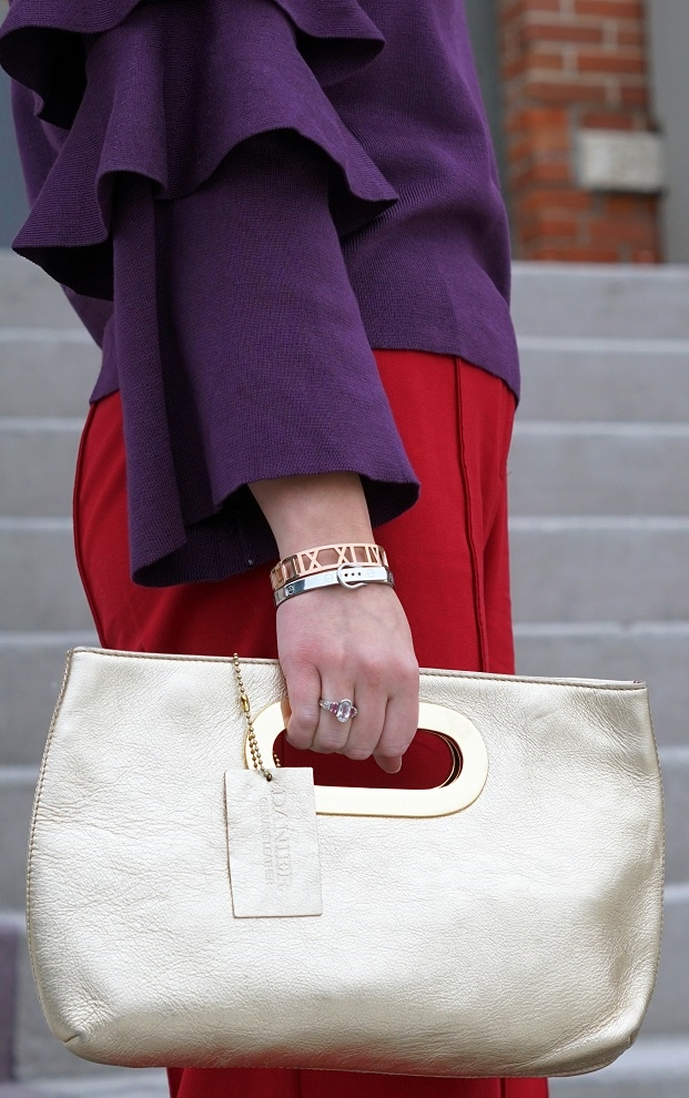 Winnipeg Style fashion stylist, Chicwish purple knit top with tiered sleeves, ThePeachBox roman numerial pink gold bangle, buckle silver bangle bracelet, Victoria Secret wide leg red pants, Danier leather gold clutch bag