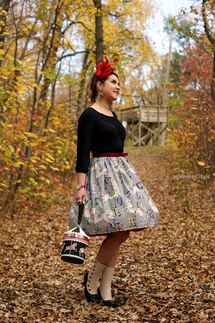 Winnipeg Style Fashion Consultant, BB and B circus carousel watch, Etsy carousel print retro vintage skirt, Nygard, Kate Spade New York Flavor of the month Carousel bag wristlet, old fashioned, Precis petite red feather fascinator, Fabcessories carousel horse earring, Fluevog spat victorian boots, unique fashion, quirky fashion