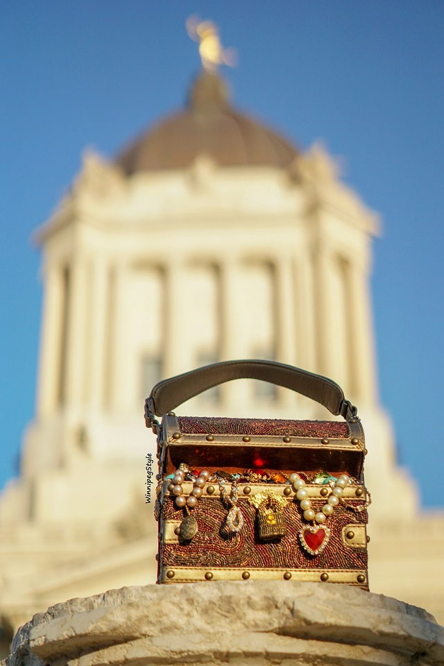 Winnipeg Style fashion blog, Canadian stylist, Mary Frances Accessories X Marks the Spot treasure chest novelty handbag bag beaded jewels, jewelry box, ocean sunken treasure, Manitoba Winnipeg Legislative building, Golden boy, Modern vintage 2018 winter