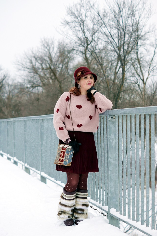 Winnipeg Style Fashion style blog, Personal shopping consultant, Chicwish cropped heart print sweater jumper, Forever 21 pleated satin short skirt, Mary Frances Accessories Best Seller book beaded clutch bag crossbody, Julie Pedersen designer urban mukluks muckies mocassin boots, Canadian winter chic style, 2019, burgundy and baby pink