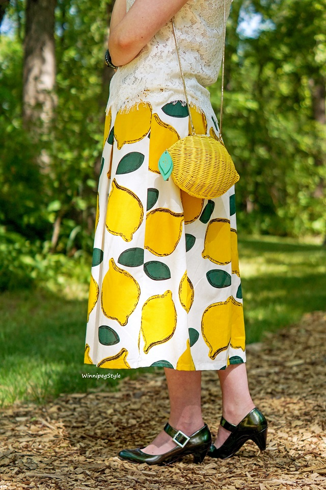 Winnipeg Style Canadian fashion stylist consultant, women's unique fashion blog, Chicwish lemon print cotton midi skirt, Kate Spade New York lemon wicker clutch handbag bag, Jessica Simpson metallic green shoes, oversized yellow straw hat, vintage style, retro, fruit print