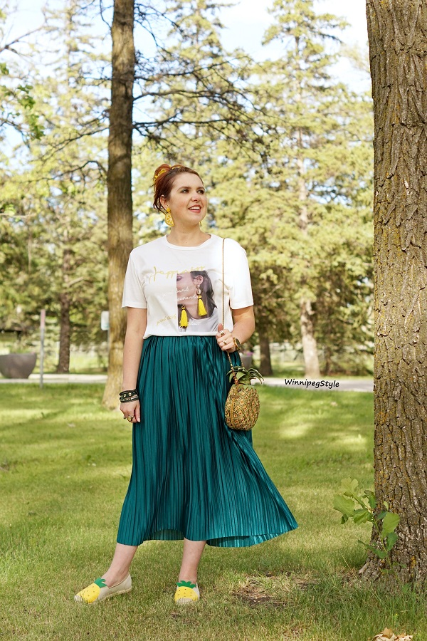 Winnipeg Style, Canadian women's fashion blog, stylist, Fashion Paradise clothing store, Embellished printed tassel earrings t-shirt, Mary Frances pineapple beaded bag, Fashion Paradise Winnipeg green satin crinkle skirt, Avon pineapple shoes